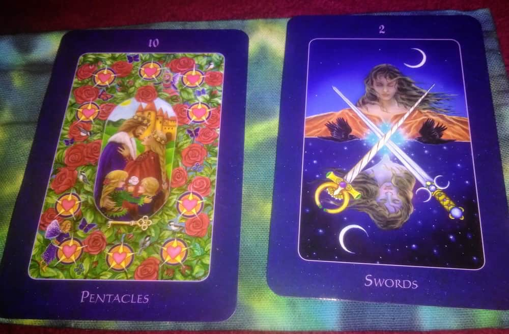 ten of pentacles two of swords tarot