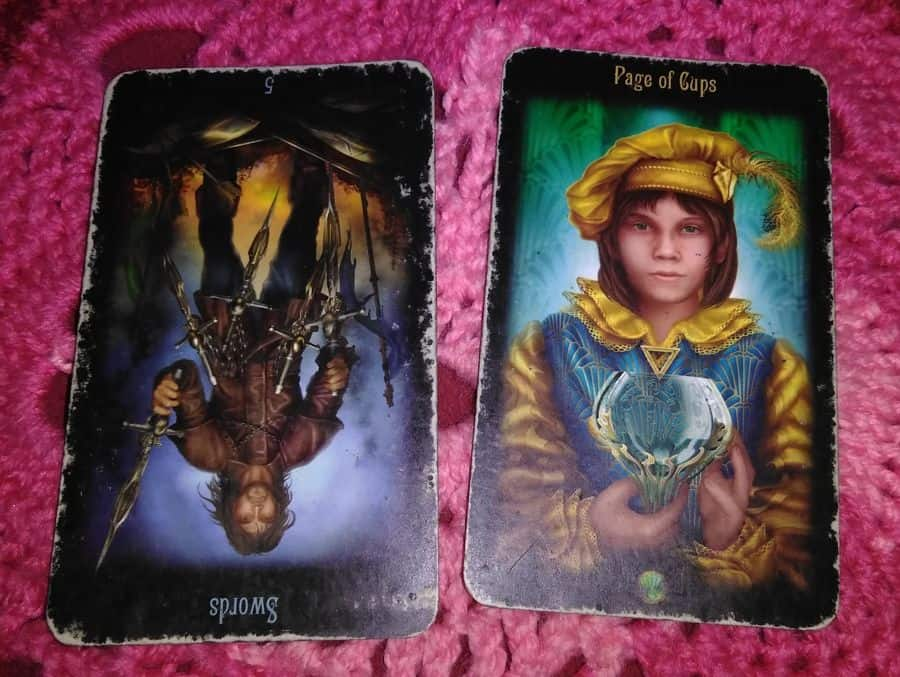 five of swords reversed page of cups tarot cards