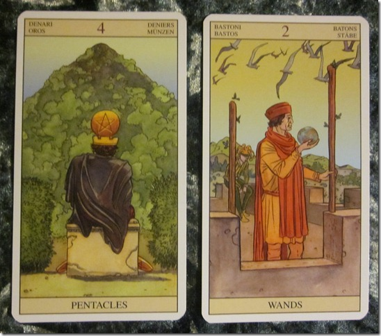 four-pentacles-two-wands-tarot-meaning