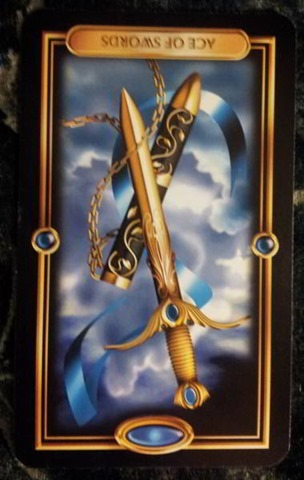 revsersed-inverted-ace-swords-guilded-tarot