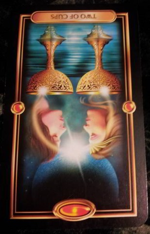 reversed-2-of-cups-gilded-tarot-meaning